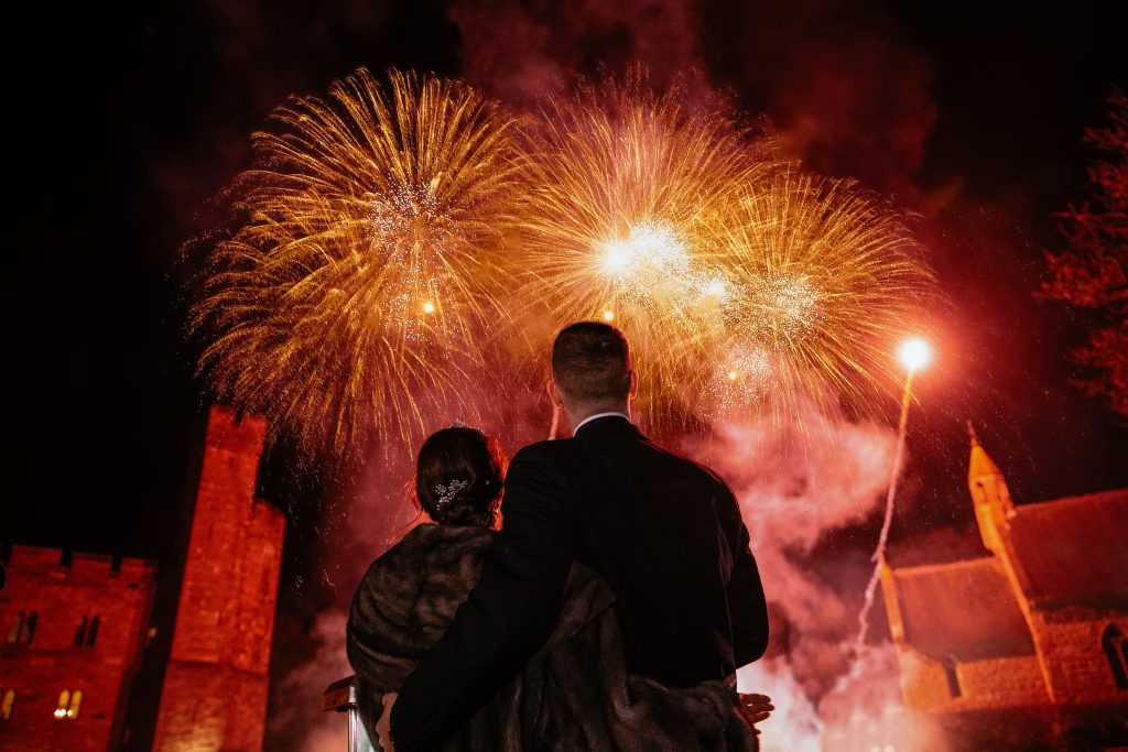 Bride and Groom watching there firework display at Peckforton Castle Fireworks By Myweddingfireworks.com